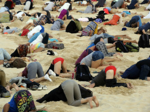 "This handout picture taken by Tim Cole and released by 350.org on November 13, 2014 shows Australians burying their heads in the sands of iconic Bondi Beach to send a message to Prime Minister Tony Abbott about the dangers of climate change. As world leaders arrived in the northern city of Brisbane for the G20 summit, more than 100 people dug holes in the famous sand so they could plunge their bodies in halfway, holding their position for three minutes. AFP PHOTO / 350.ORG / TIM COLE   ----EDITORS NOTE ---- RESTRICTED TO EDITORIAL USE - MANDATORY CREDIT "" AFP PHOTO / 350.ORG / TIM COLE "" NO MARKETING - NO ADVERTISING CAMPAIGNS - DISTRIBUTED AS A SERVICE TO CLIENTS -TIM COLE/AFP/Getty Images"